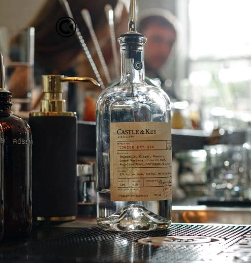 close up of castle and key gin bottle on bar